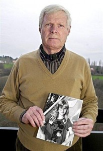 The father holding a photo of his murdered daughter