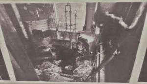 In this stove in a basement room of his townhouse Petiot burnt some of the bodies of his victims. You will see the human ash on the floor