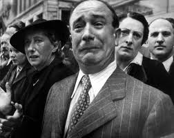 A Frenchman cries as he watches the German army march up  Avenue des Champs-Elysees.